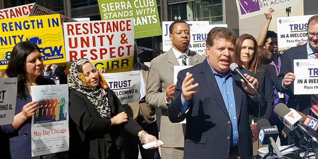 In this April 24, 2017, photo Artemio Arreola, an organizer with the Illinois Coalition for Immigrant and Refugee Rights, speaks to other advocates in downtown Chicago.