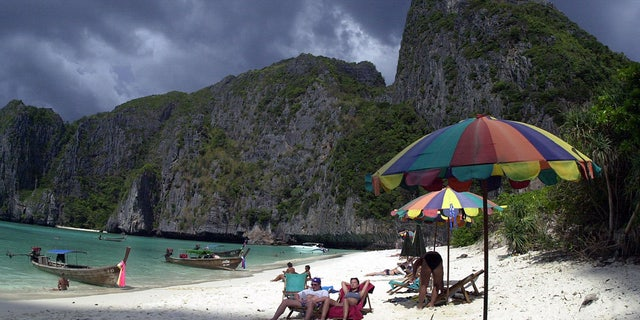 Tourists Catch The Sun S Rays On Remote Maya Beach In Southern Thailand Made Famous As