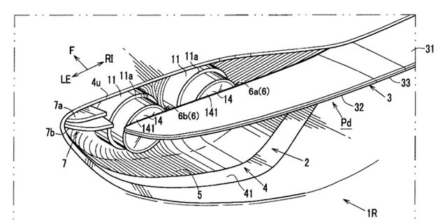 Patent drawings depict the retractable spoiler bisecting the taillights.