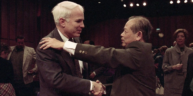 "In this Nov. 7, 1991, file photo, Sen. John McCain, R-Ariz., left, is hugged by former North Vietnam Col. Bui Tin on Capitol Hill in Washington after a hearing of the Senate Select Committee on POW and MIA affairs. Tin oversaw a military prison operation dubbed the ""Hanoi Hilton,"" where McCain was held prisoner during the Vietnam War. McCain, the war hero who became the GOP's standard-bearer in the 2008 election, died Saturday, Aug. 25, 2018. He was 81."