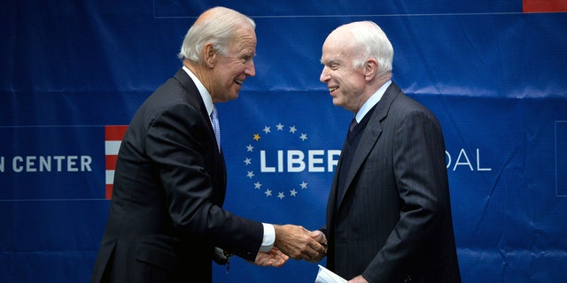 Sen. John McCain, R-Ariz., is awarded the 2017 Liberty Medal by former Vice President Joe Biden at Independence Hall in Philadelphia this past October.
