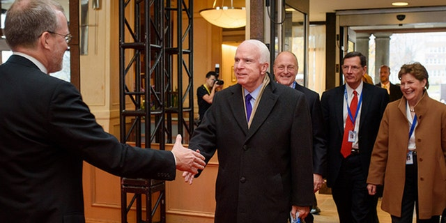 Kramer greets Sen. John McCain at the Halifax International Security Forum.