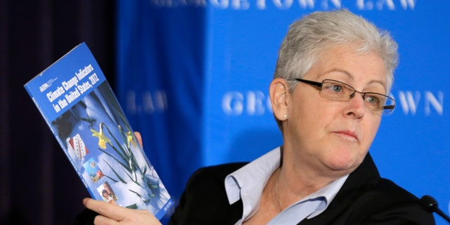 Feb. 21, 2013: Gina McCarthy, then-Assistant Administrator with the Environmental Protection Agency and current Administrator, holds a climate change report as she speaks at a climate workshop sponsored by The Climate Center at Georgetown University.