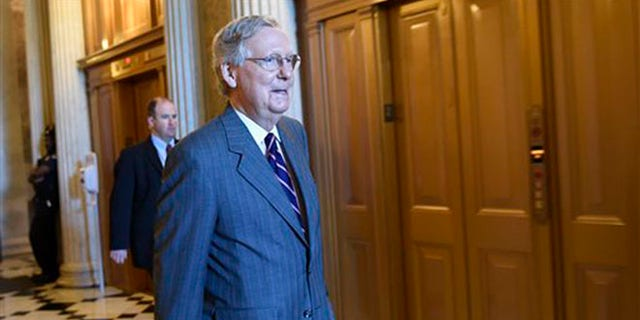 Senate Majority Leader Mitch McConnell of Ky. walks to a Republican luncheon on Capitol Hill in Washington, Friday, May 22, 2015.
