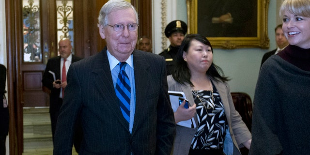 Senate Majority Leader Mitch McConnell leaves the Senate floor Sunday evening.