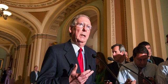 Sept. 17, 2013: Senate Minority Leader Mitch McConnell, R-Ky., speaks to reporters following a Republican caucus at the Capitol in Washington.