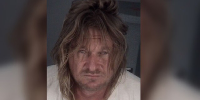 Brandon McCray, 47, is accused of slashing two people with a ninja sword after an argument over a pair of socks.