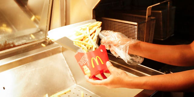 """Two Redditors claim their old McDonald's managers asked them to """"pinch"""" fry cartons to make them look fuller."""