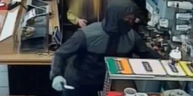 Detective Constable Emma Brookes told SWNS police are seeking any information on the robbery and hope someone might recognize the suspect from his clothes.