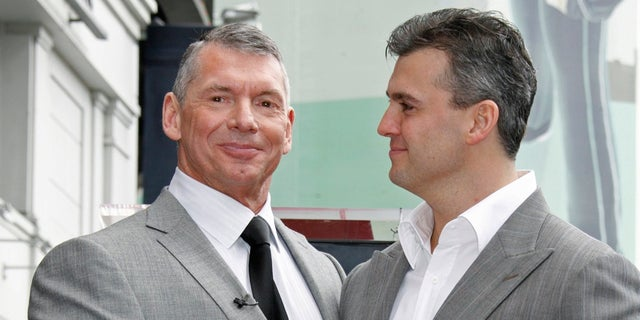 Vince McMahon (L), the chairman of World Wrestling Entertainment, Inc. holds a plaque as he poses with his son Shane after the former's Hollywood Walk of Fame star was unveiled in Hollywood, California March 14, 2008.  REUTERS/Fred Prouser      (UNITED STATES) - RTR1YB40