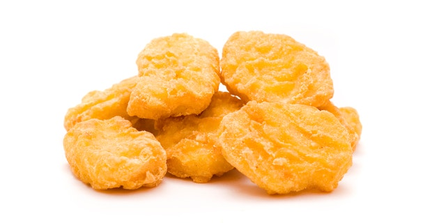 heap of chicken nuggets isolated on white background