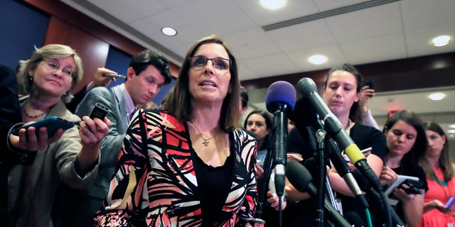 FILE - In this June 14, 2017 file photo Rep. Martha McSally, R-Ariz. speaks to reporters on Capitol Hill in Washington. McSally has told Republican colleagues that she's running for the U.S. Senate seat being vacated by Sen. Jeff Flake. McSally hasn't made a formal announcement of her intention to run in next year's Republican primary. But Arizona Rep. David Schweikert said Tuesday, Nov. 7, 2017, that she told fellow Arizona GOP members of Congress that she was running. (AP Photo/Manuel Balce Ceneta,File)