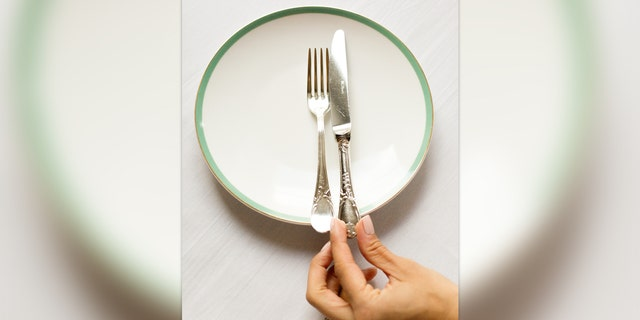 In the U.K. this is the way you leave you cutlery when you are finished with a meal.