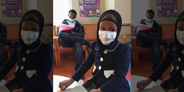 Amira Hassan went to the hospital's clinic for a routine wellness check, but she and her father both had to wear a mask to protect them from measles after an outbreak has sickened more than 30 children in Minnesota.