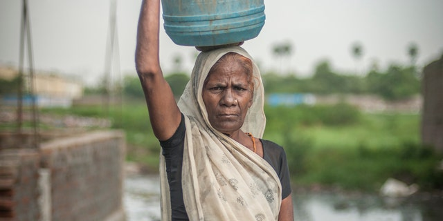 Uma Devi, aged 60-70, has worked as a manual scavenger since the aged of 11/12 in Sangi Masjid slum, Patna, Bihar, India.She has four sons and one daughter.