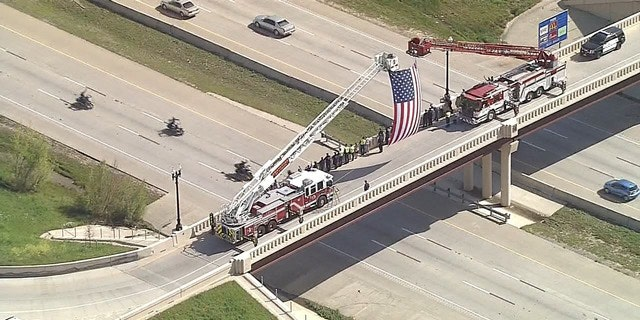 Onlookers watch the motorcade carrying Medal of Honor recipients to an event in Texas.