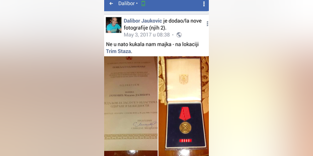 An image apparently posted to the dead bomber's Facebook page last year shows an award apparently signed by former Serbian strongman Slobodan Milosevic.