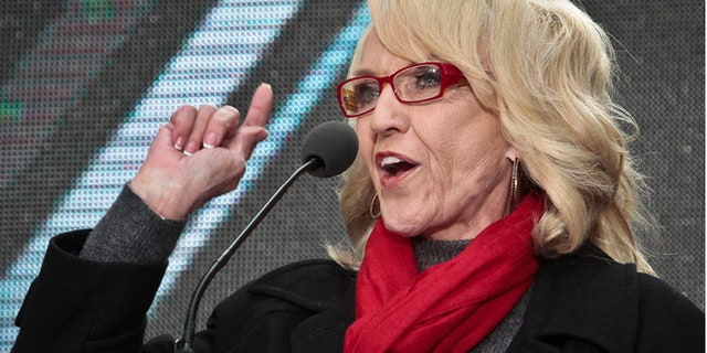 Feb. 1, 2014: This file photo shows Arizona Gov. Jan Brewer, speaks during a ceremony to pass official hosting duties of next year's Super Bowl to Arizona, in New York.