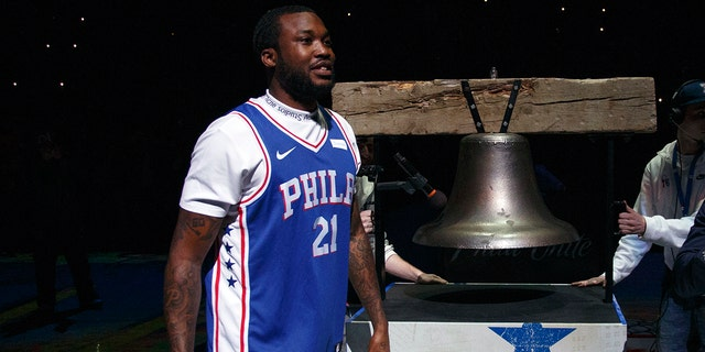 Rapper Meek Mill comes out to ring a Liberty Bell replica before the first half in Game 5 of a first-round NBA basketball playoff series between the Miami Heat and the Philadelphia 76ers, Tuesday, April 24, 2018, in Philadelphia.
