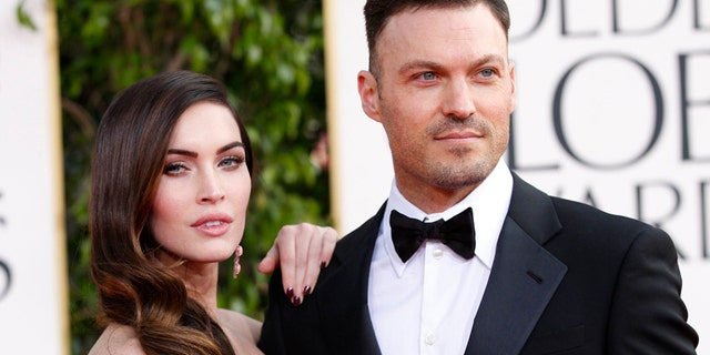 Actor Brian Austin Green and his wife, actress Megan Fox, arrive at the 70th annual Golden Globe Awards in Beverly Hills, California, January 13, 2013.