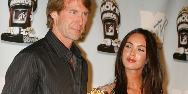 """Actress Megan Fox, star of the action film """"Transformers"""", poses with the film's director Michael Bay who holds the Best Movie award won at the 2008 MTV Movie Awards in Los Angeles June 1, 2008."""