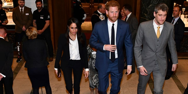 Meghan Markle and Prince Harry arrive at Goldsmith's Hall for the awards ceremony.