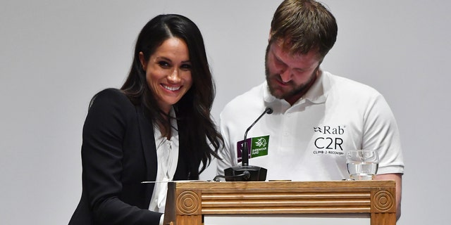 Meghan Markle gives a smile during an awkward moment while helping to present awards at the annual Endeavour Found Awards gala in London.