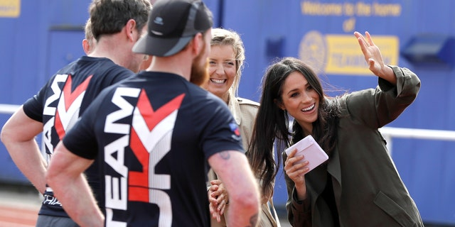 Markle meets with athletes on the track at the Invictus trials in Bath, England.