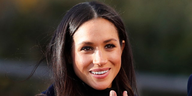 Britain's Prince Harry's fiancee Meghan Markle arrives at Nottingham Academy in Nottingham, England , Friday, Dec. 1, 2017. It was announced on Monday that Prince Harry and American actress Meghan Markle are engaged and will marry in the spring of 2018. (AP Photo/Frank Augstein)