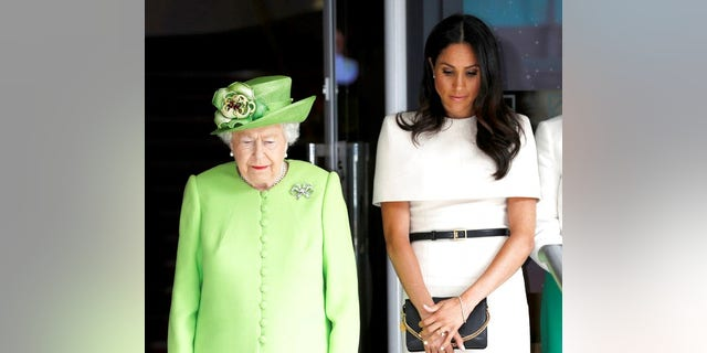 Britain's Queen Elizabeth and Meghan, Duchess of Sussex.