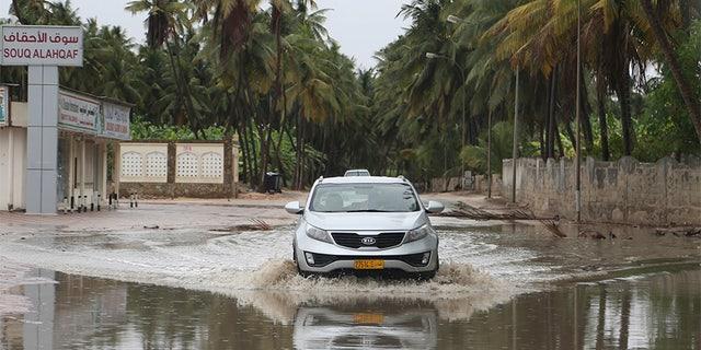 May 25, 2018: A car makes its way through standing water on a road in Salalah, Oman.