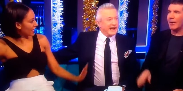 "Mel B calls out former ""X Factor"" judge Louis Walsh for grabbing her butt on live television in 2014 video."