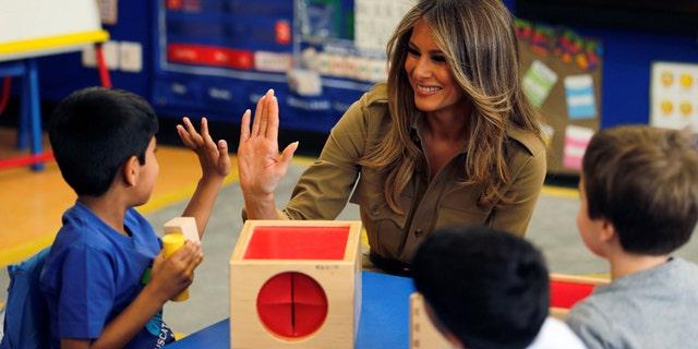 First Lady Melania Trump with children at the American International School of Riyadh, Saudi Arabia in May 2017.