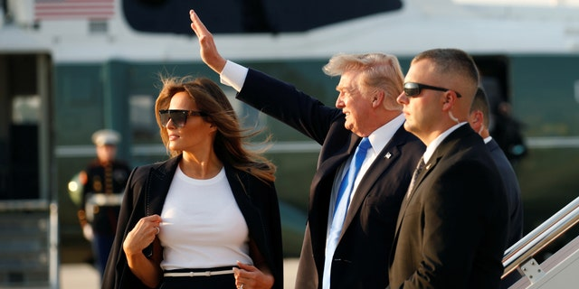 First lady Melania Trump, wearing an Escada pantsuit, boards Air Force One alongside President Donald Trump in July 2017.