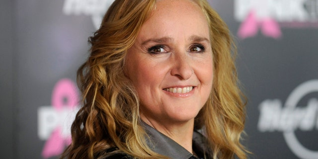 Singer Melissa Etheridge is staying at a hotel after having to evacuate her home due to a Southern California wildfire.