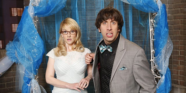 """""""The Prom Equivalency"""" -- When the gang recreates a high school prom on the roof the of the guys' apartment building, Sheldon feels pressure to participate in all the typical romantic traditions, on THE BIG BANG THEORY, Thursday, Nov. 6 (8:00-8:31 PM, ET/PT), on the CBS Television Network. Pictured left to right: Melissa Rauch and Simon Helberg Photo: Monty Brinton/CBS ©2014 CBS Broadcasting, Inc. All Rights Reserved."""