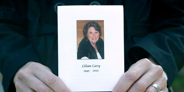 Jill Bloser, 43, of Charleston, S.C., holds a photo of her mother Lilian Cary. George Cary, whose wife's death was linked to the national outbreak of fungal meningitis said that he, too, was treated with steroids that may have been contaminated. (AP Photo/Paul Sancya, File)
