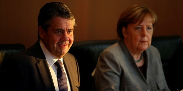 German Foreign Minister Sigmar Gabriel (left) is a supporter of the Iranian nuclear deal. German Chancellor Angela Merkel (right) confirmed Germany is one of Iran's most important trade partners.