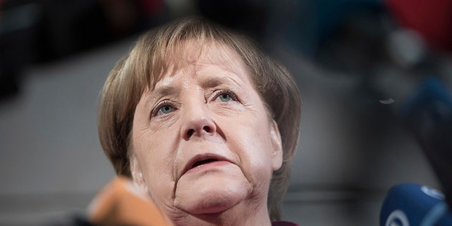 Merkel took a thinly-veiled swipe at Trump before his arrival