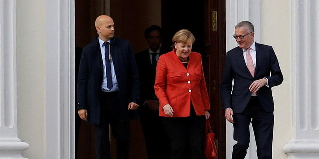 German Chancellor Angela Merkel leaves the meeting with President Frank-Walter Steinmeier after coalition government talks collapsed in Berlin, Germany, Nov. 20, 2017.