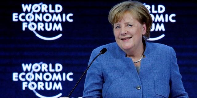 German Chancellor Angela Merkel gestures at the World Economic Forum in Davos, Switzerland.