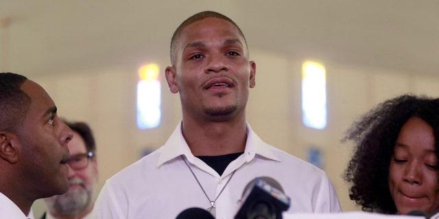 In this June 7, 2018, file photo, Robert Johnson, 35, speaks at New Beginnings Christian Church in Mesa, Ariz