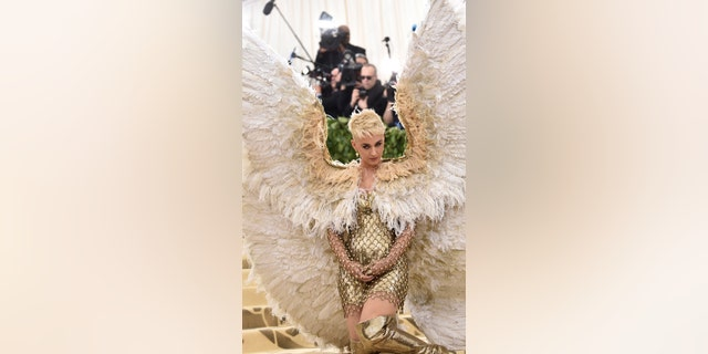 "Katy Perry at the Met Gala for the ""Heavenly Bodies: Fashion and the Catholic Imagination"" theme."