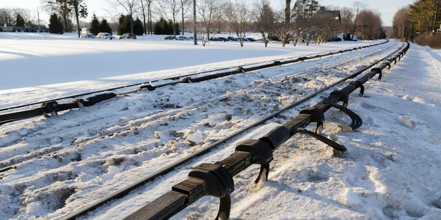 This Feb. 6, 2015, file photo shows the electrified third rail, bottom, that runs next to Metro-North Railroad tracks in Valhalla, N.Y. Federal investigators said the crash was extra deadly because of an unusual rail design.