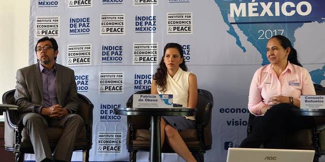 Researcher Luis Daniel Vazquez, Mexican Institute for the Economy and Peace coordinator Patricia de Obeso and Peace Promotion ABP director Consuelo Bañuelos during a press conference in Mexico City, Mexico, April 4, 2017.