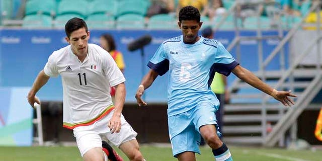 Mexico's Marco Bueno, left, fights for the ball with Fiji's Anish Khem during a group C match of the men's Olympic football tournament between Mexico and Fiji at the Fonte Nova Arena in Salvador, Brazil, Sunday, Aug. 7, 2016. (AP Photo/Arisson Marinho)