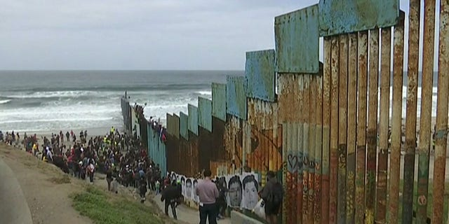 A demonstration on the border in Tijuana, Mexico, as a caravan of Central Americans prepares for their border crossing.