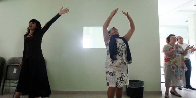 March 11, 2012: Worshippers attend a prayer in an evangelical church in Leon