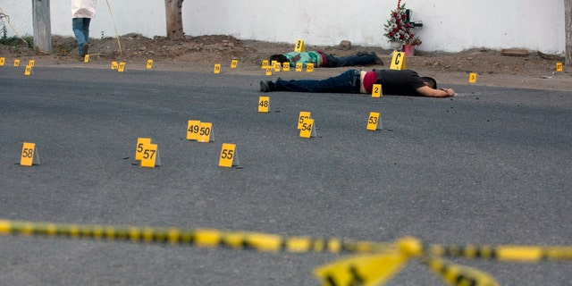 Bodies lie beside a road after a shooting in Mexico's Sinaloa state this past June.
