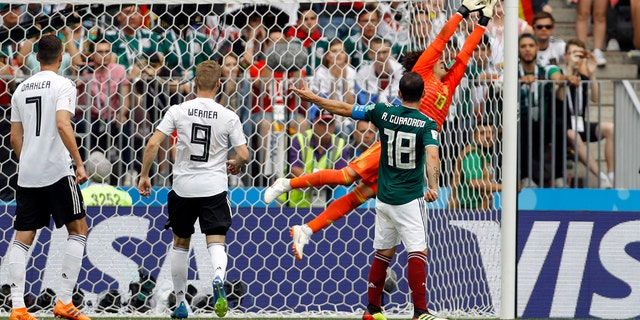 Mexico goalkeeper Guillermo Ochoa, right, jumps for the ball during the group F match between Germany and Mexico at the 2018 soccer World Cup in the Luzhniki Stadium in Moscow, Russia, Sunday, June 17, 2018.